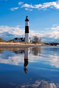 Big Sable Lighthouse--in Ludington, MI.  Walk the beach or hike the path from May to Oct.  Have bus rides some weekends.  We climbed the tower and had the most spectacular view of Lake Michigan.  You can camp in the park too!!!