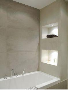 Vakken in de muur, geeft met licht erin een mooie oplossing.