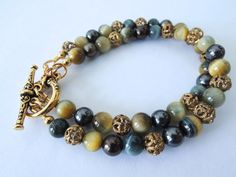 Blue Tigers Eye, Freshwater Pearl, and Vintage Filigree Double Strand – Beth Lerner Jewelry http://bethlernerjewelry.com/collections/bracelets/products/blue-tigers-eye-freshwater-pearl-and-vintage-filigree-double-strand-toggle-bracelet