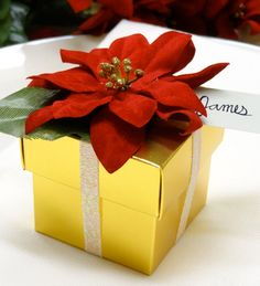 Christmas poinsettia gift box tutorial. See more party ideas at CatchMyParty.com. #diy #craft