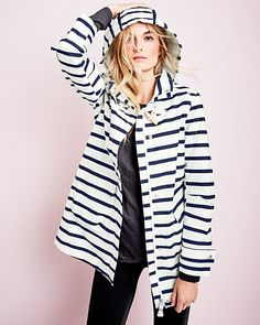 The perfect antidote to rainy days; this coat's sunny style features preppy stripes, an oversized hood, and a nautical wooden toggle — even the charming interior label will make you smile! Crafted in breathable, waterproof cotton with quality seaming at the elbows for ease and a cotton jersey-knit lining for T-shirt-like softness.