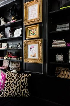 Ornate gold framed art pieces are stacked and hung front a black wall between black built-in styled cabinets located behind a black velvet sofa topped with a leopard print pillow. Black Living Room Set, Cheap Living Room Sets, Black Rooms, Black Walls, My Living Room, Living Room Decor, Striped Walls, Small Living, Dining Room