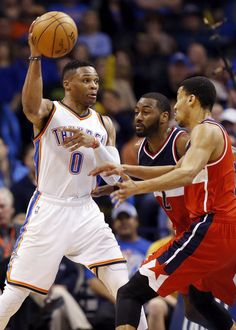 Oklahoma City's Russell Westbrook (0) passes away from Washington's John Wall (2) and Otto Porter Jr. (22), right, during an NBA basketball game between the Oklahoma City Thunder and the Washington Wizards at Chesapeake Energy Arena in Oklahoma City, Monday, Feb. 1, 2016. Oklahoma City won 114-98. Photo by Nate Billings, The Oklahoman