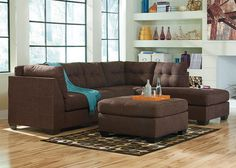 The Maier Sectional Sofa is a casual and contemporary piece of furniture perfect for your living room or family room use. Designed for homes that seek a soft and homey atmosphere, this collection features smooth pulled upholstery, comfortable seat cushions, small wood feet and button tufted back cushions. Multiple sectional configurations allow homeowners to create the arrangement that best suits their home. This collection makes a perfect casual contemporary addition to any home and…
