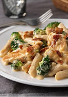 Chicken & Broccoli-Cheddar Skillet — Chicken breast strips and penne pasta are tossed with cheesy broccoli in this easy skillet recipe. Top with bacon crumbles and enjoy!