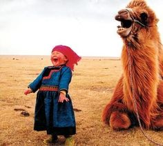 Child and camel laughing.
