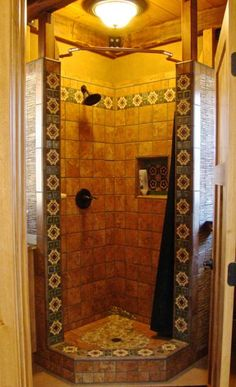 A shower, designed by Kim, trimmed in Mexican Talavera tile.  An On-Demand water heater supplies it and a kitchenette sink each only five feet from the heater.