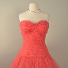 Vintage 1950s Prom Dress...Frothy Coral Pink Strapless Tea Length Tulle Prom Dress Wedding Dress Medium. $285.00, via Etsy.