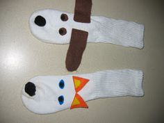 Using some kids socks we made a cat and dog sock puppet. We also used felt and fabric glue as well as pom poms for the nose.  Make sure t...