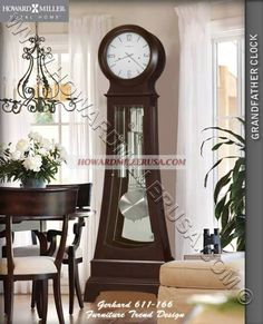 howard miller grandfather clockthis fashionable floor clock features a hinged top