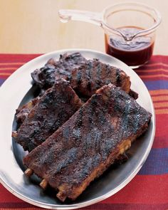Easy Barbecued Spareribs Recipe -- Bake the ribs and prepare the sauce a day ahead, and the next night you can just cut them, brush them with sauce, and grill them, all in about 10 minutes!
