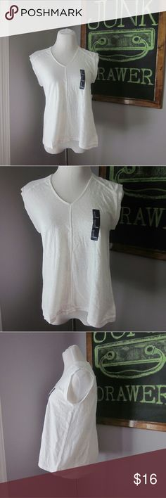 "GAP Lightweight White Paper V Neck Top XS New with tags! Great wardrobe staple / basic! Made from 100% recycled paper. Lightweight material. Bust 17"". Length 23.5"".  Photographed is size Sm but listing is for XS.  BUNDLE your likes and shoot me and OFFER! Glad to negotiate. Hundreds of items available for discounted bundle offers! GAP Tops"
