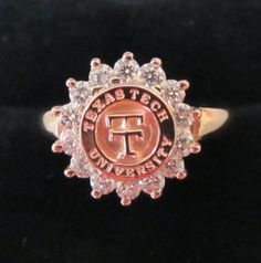 Welcome the newest member of our beautiful Texas Tech rings collection.  Rose gold with just under a full carat of diamonds!
