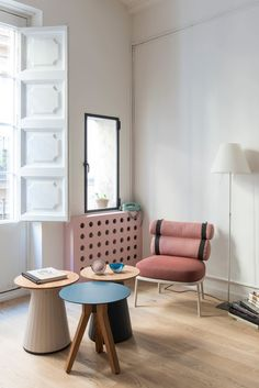 Located in Born, one of Barcelona's oldest neighborhoods, this 65-square-meter apartment has a new layout with vaulted ceilings, a playful color scheme, and original details, thanks to Colombo and Serboli Architecture.