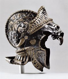 """Burgonet """"ALLA ROMANA ANTICA"""" Created for The Archduke Ferdinand II of Tyrol, Ambrass and Innsbruck.  Ceremonial Parade Helmet designed and created by the famed studio of Filippo Negroli, a Sixteenth Century Armorer in Milan, Italy.Bronze, Steel, Gold and Brass."""