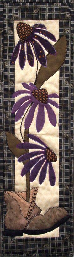 "Patch Abilities Pattern P62 Purple Coneflowers. These pretty little flowers are featured in boot! How clever!! This is a beginner friendly quilting project that finishes at a 6"" x 22"" size. Perfect wall hanging for that small space. Pick up yours today!"