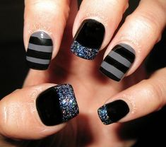 Black and gray nail art combination. The best combination that you can paint on in striped design and you can even add silver glitter as French tips for effect.