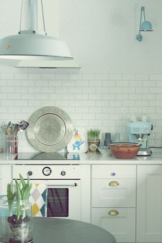 subway tile + vintage lighting + white cabinets