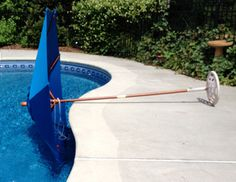 Pool Umbrellas Require The Right Weight For The Umbrella Stand. Placing It  Through The Hole In An Umbrella Patio Table Offers Additional Stability.