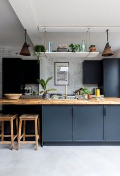 This industrial style kitchen in a London cottage boasts a stylish teal colour theme, clas. Dark Blue Kitchen Cabinets, Dark Blue Kitchens, Green Kitchen, New Kitchen, Kitchen Wood, Dark Cabinets, Kitchen White, Awesome Kitchen, Modern Kitchens