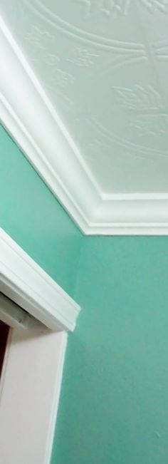 close up of crown molding and textured ceiling tiles.