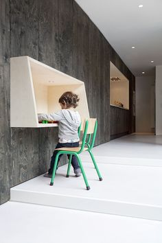 great kid's desk attached to the wall