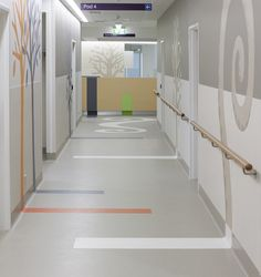 Stripe on floor, up to graphic on wall for wayfinding.   Sunshine Hospital #healthcare #flooring #design