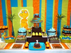 Dinosaur Train Dessert Table by #CupcakeWhimsy www.CupcakeWhimsy.com #Naperville Illinois