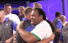 Former BYU defensive lineman Henry Bloomfield, right, hugs former BYU tight end Chad Lewis during a reunion for the 1996 BYU football team at the BYU Broadcast Building on Thursday, June 30, 2016, in Provo.