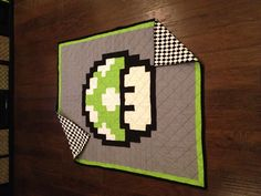 Finished my 1-Up quilt inspired by the life extending mushroom of the Super Mario World!