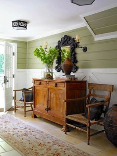 color scheme. green and white walls, brown furniture