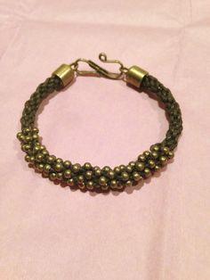 Kumihimo bracelet with brass beads