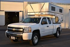 Truck campers are the ultimate Go Anywhere, Camp Anywhere, Tow Anything RV. Forget motorhomes and trailers. Fun, freedom, and adventure await! Short Bed Truck Camper, Slide In Truck Campers, Truck Bed Camping, Pickup Camper, Rv Bus, Bus House, Silverado 1500, Four Wheel Drive, House On Wheels