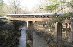 The Clarkson–Legg Covered Bridge is a county-owned wooden covered bridge that spans Crooked Creek in Cullman County, Alabama, United States. It said to be the second longest covered bridge in Alabama.