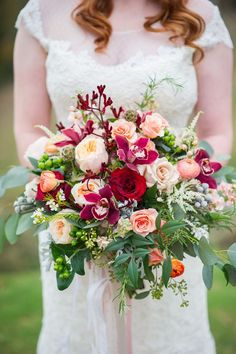 Glorious, lush, full bridal bouquet. David Austin's Juliet garden rose takes center stage along with cymbidium orchids, Black beauty roses, Quicksand roses, stock, ranunculus, brunia berries, astilbe, rosemary, kangaroo paw, and assorted foliage.