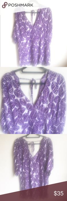 Torrid Kimono Purple Leaves Top 3X Light weight top, white background with purple leaves veined in gold. V-neck, V in back with a tie at the top, short sleeves and curved bottom hem.  (E)  23 inches across the bust, 26 inches shortest length, 28 inches longest length.   🌷Thank you for visiting my closet! torrid Tops Tees - Short Sleeve