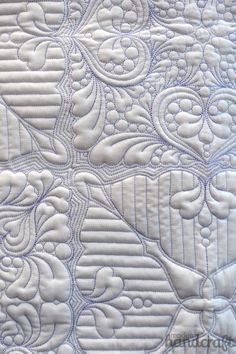 Love the intricate quilt pattern and coloured thread on white.  Modern Handcraft - Fall Quilt Market 2014