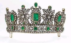 Emerald, foil-back beryl, diamond and silver-topped gold tiara designed with a lower band surmounted by foliate and crest-shaped ornaments, set throughout with emerald-cut, pear-shaped and round emeralds and foil-back beryl, accented by rose-cut diamonds