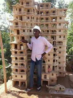 This 16 years old boy constructed this eleven story building with bamboo sticks and pieces of cartoon.