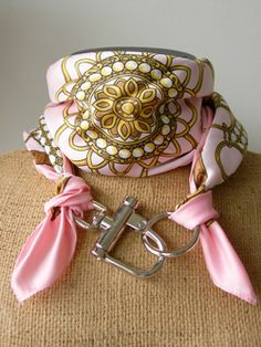 "LILO Collections - Scarf w/ Clip - #132046 - Inspired by a carriage hardware quick-release piece - Shackle clip and ring with an equestrian scarf - Multiple uses (scarf, belts) - Scarf in Photo = ""Lorena"" 35"" scarf: in pink - See website for other color & scarf options."