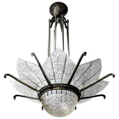 French Art Deco Chandelier Signed by Hettier Vincent   From a unique collection of antique and modern chandeliers and pendants at https://www.1stdibs.com/furniture/lighting/chandeliers-pendant-lights/