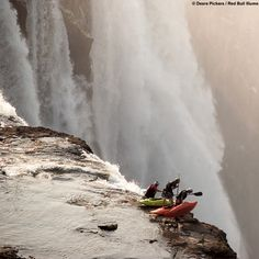 Living on the edge: Extreme kayakers look over the brink of Victoria Falls in Zambia.  Photo by Desre Pickers