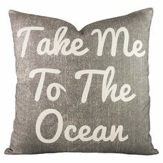 A delightful addition to your favorite arm chair or sofa, this lovely cotton pillow features a bold typographic motif and gray hue.