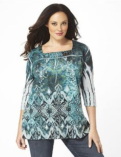 A flourishing, abstract print creates a spellbinding design along this enchanting top. Sequins and studs accent the square neckline. Three-quarter sleeves are complete with flattering, intricate folds. Catherines tops are perfectly proportioned for the plus size woman. catherines.com