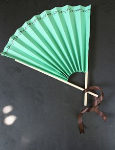 A fan idea for my section on China . . . nicer than the folded paper fans, but not too hard for the kids . . .