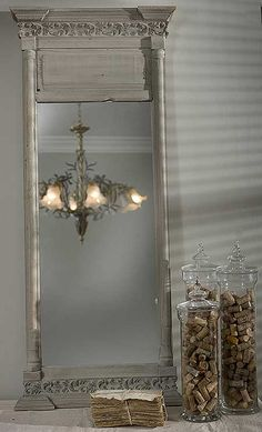 This mirror, with the frame maybe a dark green or a deep orange?