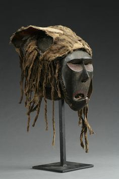 A Chokwe or Mbunda dance mask Democratic Republic of Congo/Zambia, of unusual form, with angular facial planes and a rising elongated and pointed chin. The original coiffure intact, with remains of pigmentation. height 11in FOOTNOTES Provenance:  William Bertrand  Felix (1998) discusses masks of this general type as representing a baboon. This particular example probably comes from Zambia and may have been used by the Mbunda or related Chokwe groups.