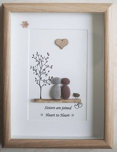 This is a beautiful small Pebble Art framed Picture of Sisters - Sisters are joined Heart to Heart handmade by myself using Pebbles, Driftwood and Wooden Heart Size of Picture incl Frame : approx. 22cm x 17cm This Picture is finished and only available as shown in Photo Thanks for looking