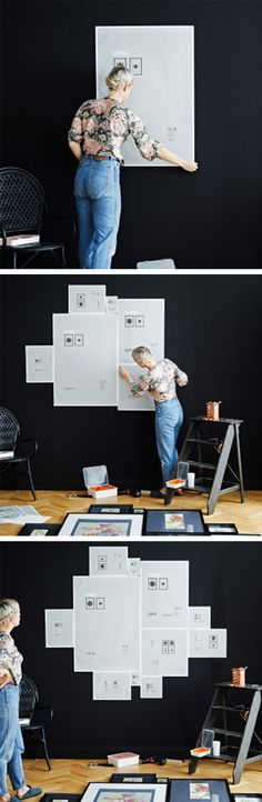 Use the frame backing papers to mark everything out on the wall. Make your biggest frame the focal point of your collection and build from there.