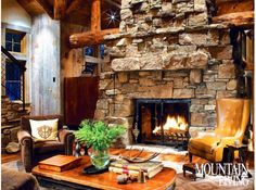 rustic, Western, industrial, Montana home, Yellowstone Club, stone fireplace, log beams, standing dead spruce beams, wing chair, Hickory Chair, antique mining cart table, horse buggy chandelier ARCHITECTURE by Faure Halvorsen Architects INTERIOR DESIGN by Peace Design CONSTRUCTION by Highline Partners PHOTO by Gibeon Photography MORE INFO at: http://www.mountainliving.com/article/rustic-redefined-0#